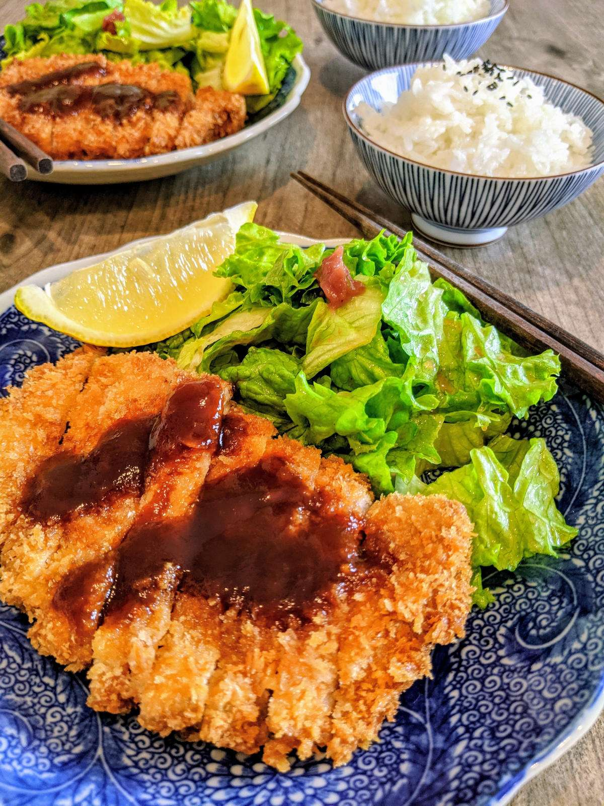Tonkatsu with two plates close-up
